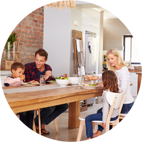 IMAGE of a family eating dinner around the dining table asking children questions