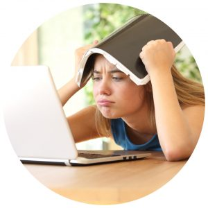 Organising Students key learnings from 2020 - girl getting bored whilst using laptop and puts a book on her head