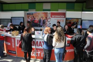 students seeking information at a university open day