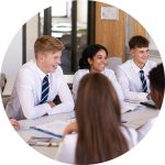 Organising Students - Image of students in a classroom sitting around learning