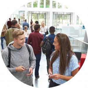 Image of university students in a foyer - organising students - Is your next step going to university or completing further studies?